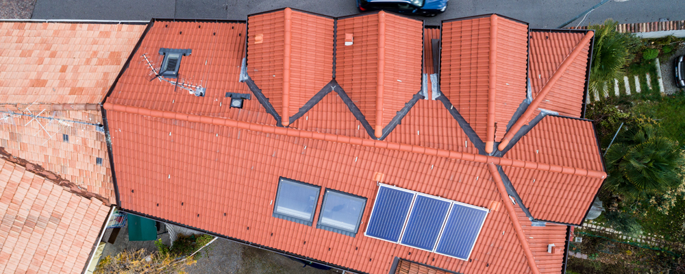 Aerial photos of a home roof with solar panels