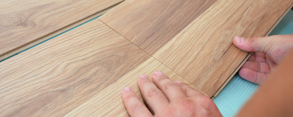 Installing laminate flooring fitting the next piece