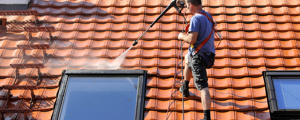 Man cleaning a roof