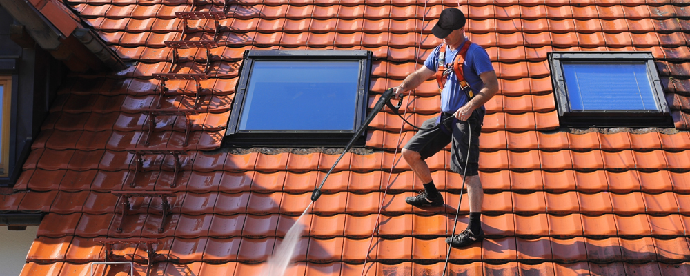 Man water cleaning the roof