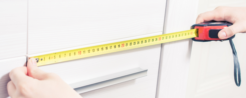 Measuring The Door Size Of A Cupboard With Measuring Tape