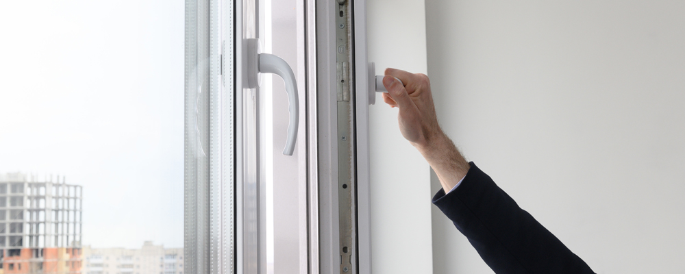 security system on the windows. Male hand opens a window. Smart home