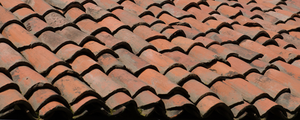 Roof of an ancient house with ancient and old tiles.