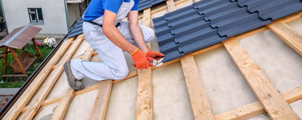 Man installing roof plate