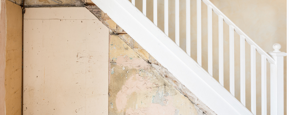 Old bare wall and stairs