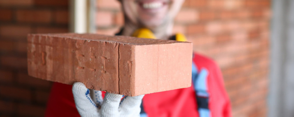 Worker holding brick