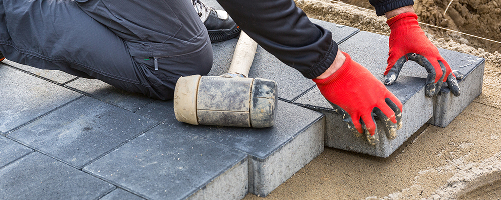 Installing concrete paver blocks